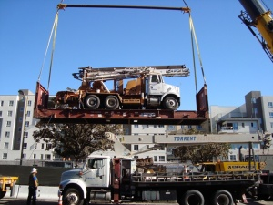 Drill Rig Lifted By Crane