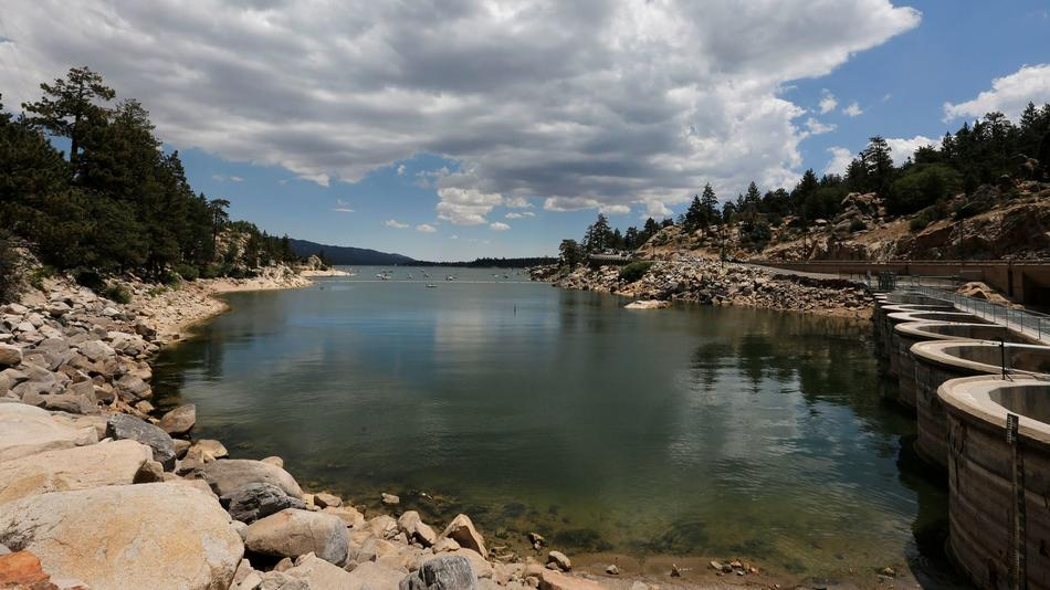 After several years of drought, the rocky shoreline of Big Bear Lake is exposed near the dam on July 27. (Los Angeles Times